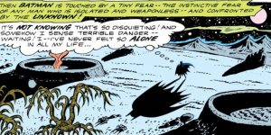 Batman wanders an alien landscape.