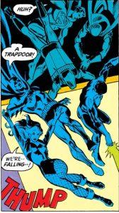The JLA tumbles through a trapdoor.